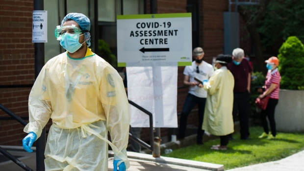 People line up to be tested at a COVID-19 assessment centre in Toronto on Tuesday, May 26, 2020. Health officials and the government have asked that people stay inside to help curb the spread of COVID-19. THE CANADIAN PRESS/Nathan Denette