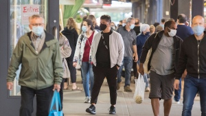 People wear face masks as they walk through a market in Montreal, Sunday, Sept. 13, 2020, as the COVID-19 pandemic continues in Canada and around the world. The Quebec government has introduced fines for individuals caught not wearing face masks or coverings in indoor public spaces. THE CANADIAN PRESS/Graham Hughes
