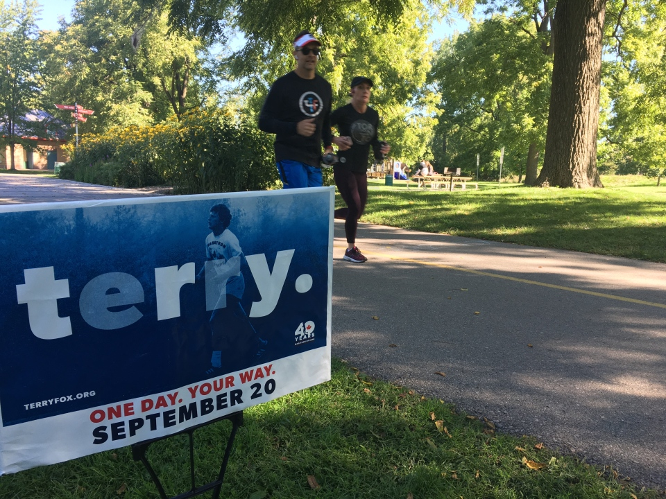 Runners are seen along Terry Fox Parkway in London, Ont. on Sunday, Sept. 20, 2020.