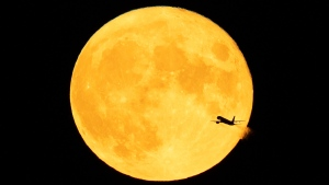 A full moon, which in August is known as a sturgeon moon, is pictured from Minneapolis. (Jeff Wheeler/Star Tribune/Getty Images)