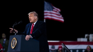 U.S. President Donald Trump speaks during a campaign rally at Fayetteville Regional Airport, Saturday, Sept. 19, 2020, in Fayetteville, N.C. (AP Photo/Evan Vucci)