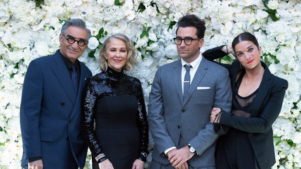 """The cast of """"Schitt's Creek"""" Eugene Levy, left to right, Catherine O'Hara, Daniel Levy and Annie Murphy pose at their Emmy Awards celebration party in Toronto on Sunday, September 22, 2020 in this handout photo. THE CANADIAN PRESS/HO, Ana Sorys"""