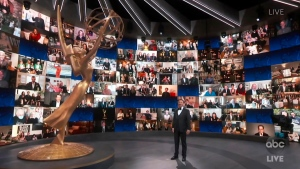 In this video grab captured on Sept. 20, 2020, courtesy of the Academy of Television Arts & Sciences and ABC Entertainment, host Jimmy Kimmel appears with a screen filled with nominees during the 72nd Emmy Awards broadcast. (The Television Academy and ABC Entertainment via AP)
