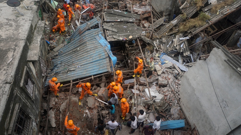 Rescuers look for survivors after a residential building collapsed in Bhiwandi in Thane district, a suburb of Mumbai, India, Monday, Sept. 21, 2020. (AP Photo/Praful Gangurde)