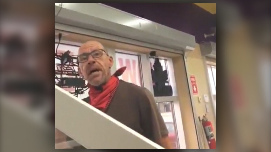 Video still of a man who released a verbal tirade filled with obscenities and racial slurs at a liquor store employee in Calgary after being asked to wear a face mask (supplied)