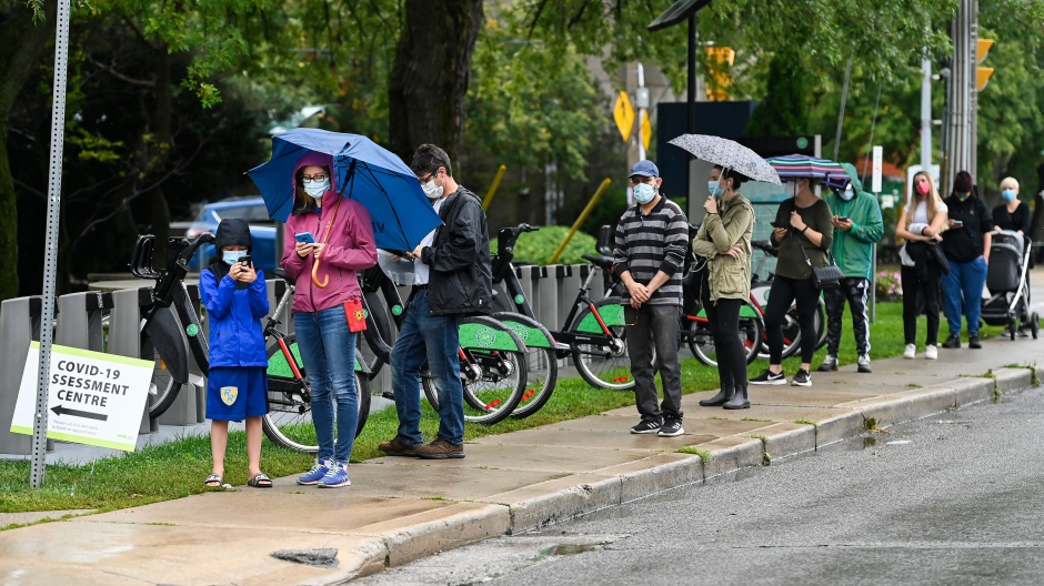 People line up to be tested for COVID-19 at a testing centre in Toronto on Sunday, Sept. 13, 2020. THE CANADIAN PRESS/Nathan Denette