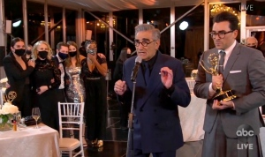 "In this video grab captured on Sept. 20, 2020, courtesy of the Academy of Television Arts & Sciences and ABC Entertainment, Annie Murphy, from left, Catherine O'Hara, Noah Reid, Sarah Levy, Karen Robinson, Eugene Levy and Daniel Levy accept the award for outstanding comedy series for ""Schitt's Creek"" during the 72nd Emmy Awards broadcast. (The Television Academy and ABC Entertainment via AP)"