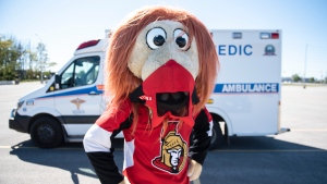 Spartacat, the official mascot of the Ottawa Senators, wears a mask as he stands for a photo at a drive through, pop-up COVID-19 test centre administered by paramedics outside the Canadian Tire Centre, home of the NHL team, in Ottawa, Sunday, Sept. 20, 2020. (Justin Tang/THE CANADIAN PRESS)