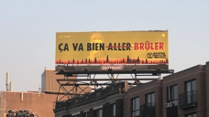 Climate activist group Extinction Rebellion hijacked a billboard in Montreal's Mile End neighbourhood overnight between Sunday and Monday.