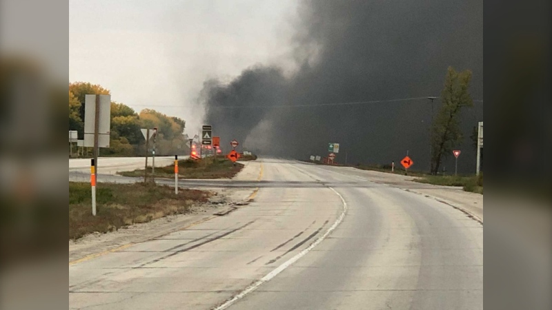 The semi-truck rolled over and went on fire. (Source: Manitoba RCMP/Twitter)