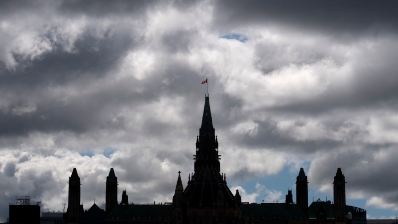 Clouds pass by the parliament builidings Wednesday August 19, 2020 in Ottawa. Parliament will resume Sept. 23 with a Speech from the Throne after it was prorogued Tuesday. THE CANADIAN PRESS/Adrian Wyld
