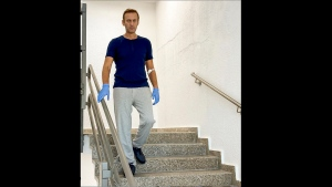 In this photo taken from a video published by Russian opposition leader Alexei Navalny on his instagram account, Russian opposition leader Alexei Navalny walks down stairs in a hospital in Berlin, Germany, Saturday, Sept. 19, 2020. (Navalny Instagram via AP)