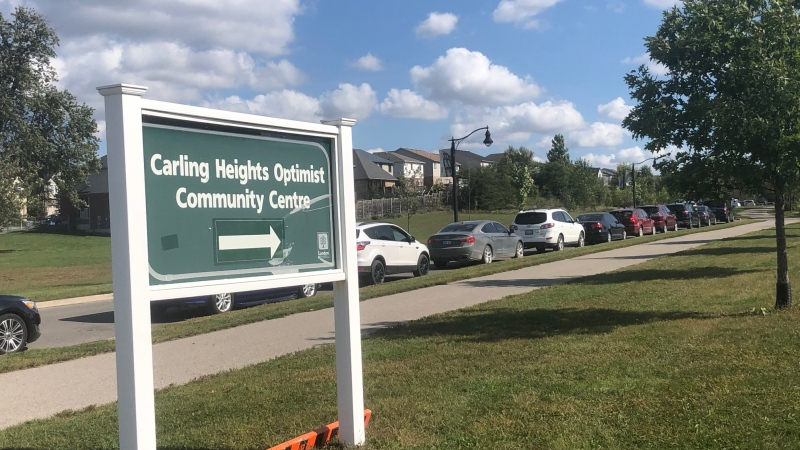 Cars line up for testing at the Carling Heights COVID-19 Assessment Centre in London, Ont. on Monday, Sept. 21, 2020. (Jim Knight / CTV News)