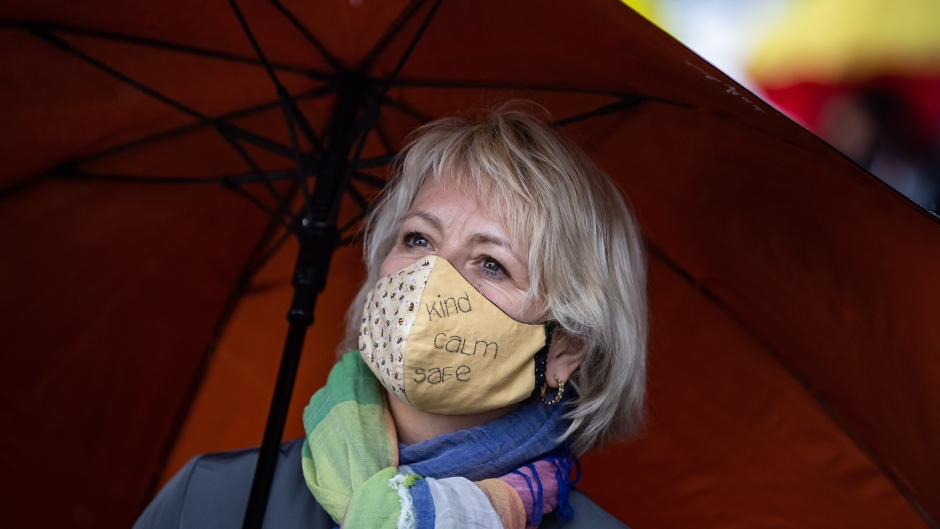 British Columbia provincial health officer Dr. Bonnie Henry wears a face mask as she views the Murals of Gratitude exhibition in Vancouver, on Friday, July 3, 2020. (Darryl Dyck / THE CANADIAN PRESS)