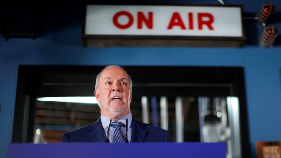 NDP Leader John Horgan speaks at a news conference at Phillips Brewery in Victoria on Thursday, Sept.17, 2020. (Chad Hipolito / THE CANADIAN PRESS)