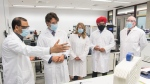 Prime Minister Justin Trudeau, second left, speaks with scientist Krishnaraj Tiwari, left, as Minister of Economic Development Melanie Joly, centre, Minister of Science and Industry Navdeep Bains and NRC President Iain Stewart, right, look on during a visit to the National Research Council of Canada (NRC) Royalmount Human Health Therapeutics Research Centre facility in Montreal, Monday, Aug 31, 2020. THE CANADIAN PRESS/Graham Hughes