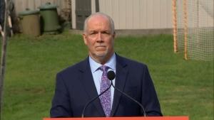 NDP Leader John Horgan speaks to media from Langdale, B.C., on Monday, Sept. 21, 2020.