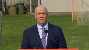 NDP Leader John Horgan speaks to media from Langford, B.C., on Monday, Sept. 21, 2020.