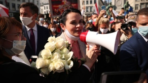 Belarus opposition leader Sviatlana Tsikhanouskaya holds flowers as she joins in a demonstration outside the European Parliament Brussels, Monday, Sept. 21, 2020. (AP Photo/Francisco Seco)