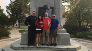 Left to right- Neil Anderson, Paula Ashe, Lyle Ashe, James Simpson, {back row} Lucas Simpson at the location of the last clue. (Courtesy Neil Anderson)