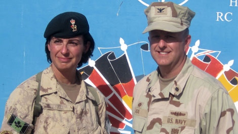The outgoing commander of the Role 3 Hospital at Kandahar Airfield, Col. Danielle Savard and the incoming commander U.S. Navy Capt. Darin Via, speaks to reporters at a changeover ceremony in Kandahar, Afghanistan, Thursday, Oct. 15, 2009. (THE CANADIAN PRESS/Bill Graveland)