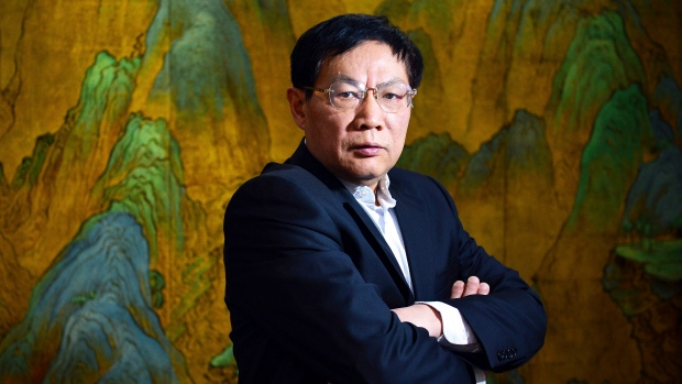 In this Dec. 3, 2012, file photo, Chinese real estate mogul Ren Zhiqiang poses for photos in his office in Beijing, China. (Color China Photo via AP, File)