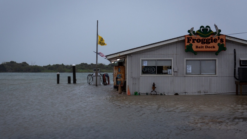 The storm surge from Tropical Storm Beta floods Froggie's Bait Dock in Port O'Connor, Texas, Monday, Sept. 21, 2020, as the storm moved into the area. (Emree Weaver/The Victoria Advocate via AP)