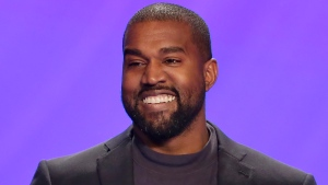 In this Nov. 17, 2019, file photo, Kanye West appears on stage during a service at Lakewood Church in Houston. (AP Photo/Michael Wyke, File)