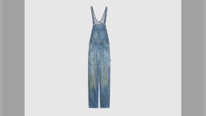 Gucci is selling denim overalls that look as though they have grass stains around the knee area for $1,750. (Courtesy Gucci)