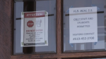 Signs about COVID-19 in the door at H.B. Beal Secondary School in London, Ont. are seen Monday, Sept. 22, 2020.