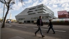 A pedestrians walk past Edmonton's Stanley A. Milner Library which reopened to the public after renovations, in Edmonton Alta, on Thursday September 17, 2020. THE CANADIAN PRESS/Jason Franson