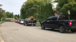 Cars line up along the street for the Oakridge Arena COVID-19 Assessment Centre in London, Ont. on Tuesday, Sept. 22, 2020. The queue almost completely surrounded Oakridge Acres Park. (Celine Zadorsky / CTV News)