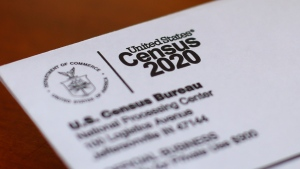 In this Sunday, April 5, 2020 file photo, An envelope containing a 2020 census letter mailed to a U.S. resident is shown in Detroit. A top lawmaker says the Trump administration is seeking to delay deadlines for the 2020 census because of the coronavirus outbreak. U.S. Rep. Carolyn Maloney said Monday, April 13, 2020 that administration officials also were asking that the timetable for releasing apportionment and redistricting data used to draw congressional and legislative districts be pushed back. (AP Photo/Paul Sancya, File)