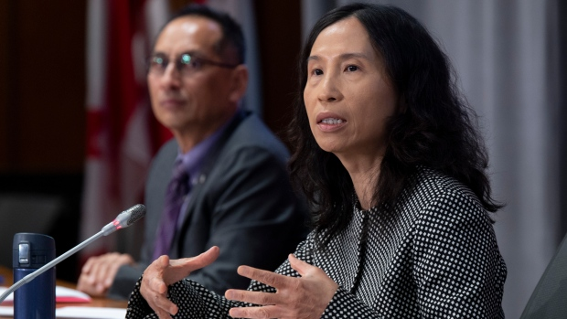 Deputy Chief Public Health Officer Howard Njoo looks on as Chief Public Health Officer Theresa Tam responds to a question during a news conference Tuesday September 22, 2020 in Ottawa. THE CANADIAN PRESS/Adrian Wyld