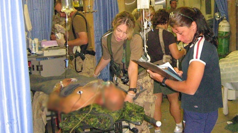 Medical staff at the Role 3 multinational hospital at the Kandahar Airfield treat an injured soldier, Sept. 18, 2006. (Department of National Defence)