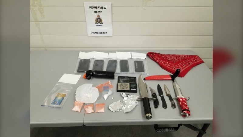 During the investigation, officers found 28 grams of meth, weapons, and drug paraphernalia. (Source: Manitoba RCMP)
