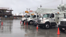 Power trucks from New Brunswick are seen on standby in Halifax in Sept, 22, 2020.