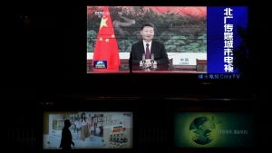 Chinese President Xi Jinping appears on an outdoor screen in Beijing as he speaks by video link at the United Nations General Assembly. (AFP)