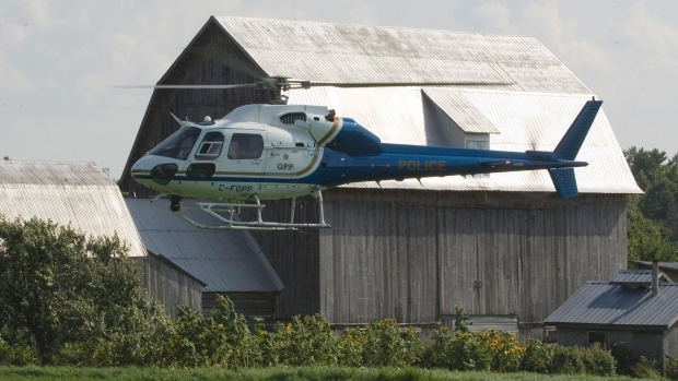 An Ontario Provincial Police lands at a farm in Renfrew, Ont., on Tuesday,  July 31, 2007. (CP PHOTO/Fred Chartrand)CANADA
