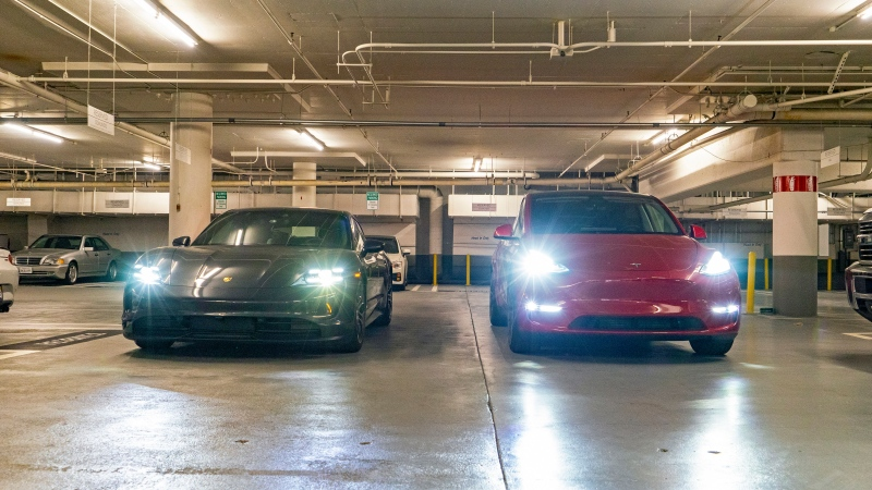 This photo provided by Edmunds shows a 2020 Porsche Taycan and 2020 Tesla Model Y Performance at the beginning of a daylong range and consumption test. (Rex Tokeshi-Torres/Edmunds via AP)