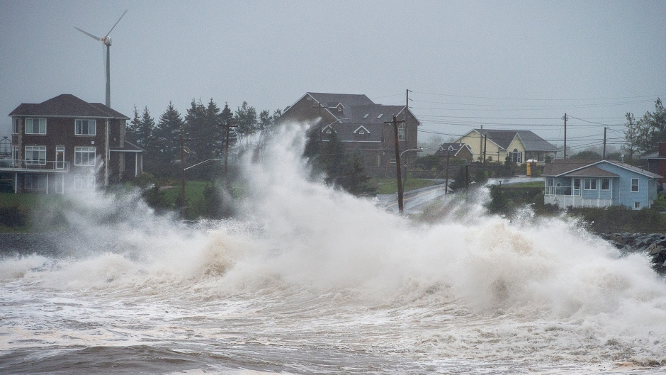 Waves batter the shore in Cow Bay, N.S., on Wednesday, Sept. 23, 2020. Hurricane Teddy has impacted the Atlantic region as a post-tropical storm, bringing rain, wind and high waves. (THE CANADIAN PRESS/Andrew Vaughan)