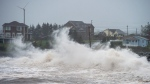 Waves batter the shore in Cow Bay, N.S., on Wednesday, Sept. 23, 2020. Hurricane Teddy impacted the Atlantic region as a post-tropical storm, bringing rain, wind and high waves. (THE CANADIAN PRESS/Andrew Vaughan)