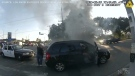 Bodycam footage shows LAPD officers rushing to rescue a man in a wheelchair from a smoky car wreck moment before it bursts in flames.