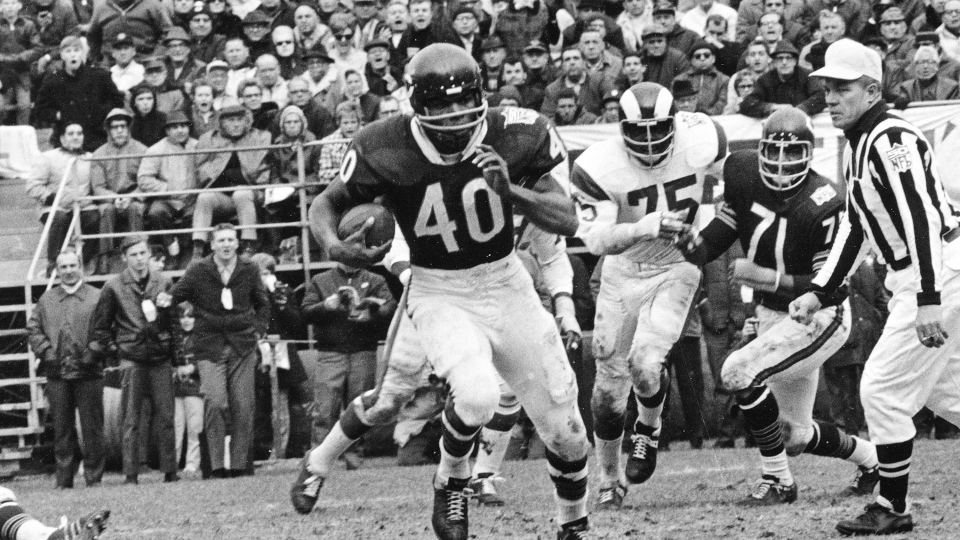 FILE - In this Oct. 27, 1969, file photo, Chicago Bears running back Gale Sayers (40) runs for a 28-yard gain against the Los Angeles Rams, in Chicago, Ill. (AP Photo/File)
