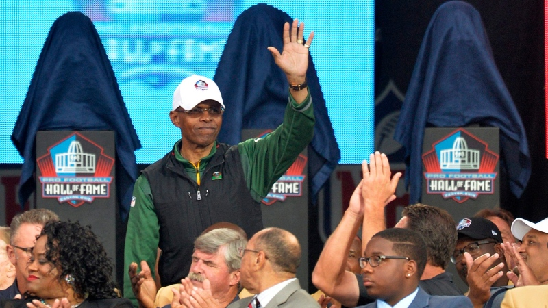 FILE - In this Aug. 2, 2014, file photo, Gale Sayers is introduced during the Pro Football Hall of Fame enshrinement ceremony in Canton, Ohio. (AP Photo/David Richard, File)