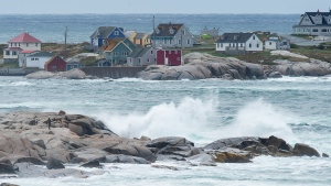 Waves batter the shore in Peggy's Cove, N.S., on Wednesday, Sept. 23, 2020. Hurricane Teddy has impacted the Atlantic region as a post-tropical storm, bringing rain, wind and high waves. (THE CANADIAN PRESS/Andrew Vaughan)
