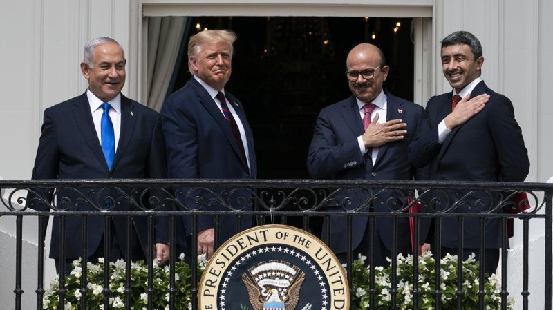 Israeli Prime Minister Benjamin Netanyahu, left, U.S. President Donald Trump, Bahrain Foreign Minister Khalid bin Ahmed Al Khalifa and United Arab Emirates Foreign Minister Abdullah bin Zayed al-Nahyan react on the Blue Room Balcony after signing the Abraham Accords during a ceremony on the South Lawn of the White House, Tuesday, Sept. 15, 2020, in Washington. (AP Photo/Alex Brandon)