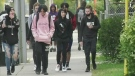 High school students walk in downtown London, Ont. on Tuesday, Sept. 22, 2020. (Marek Sutherland / CTV News)