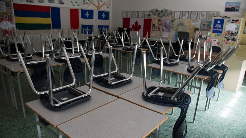 A empty classroom is pictured at Eric Hamber Secondary school in Vancouver, B.C. Monday, March 23, 2020. (THE CANADIAN PRESS/Jonathan Hayward)