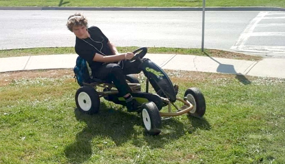 When the school bus was cancelled and his bike needed repairs, Griffin Whorley began pedaling his go kart to St. Charles College each day. He normally wears a helmet, but didn't while posing for pictures. (Supplied)